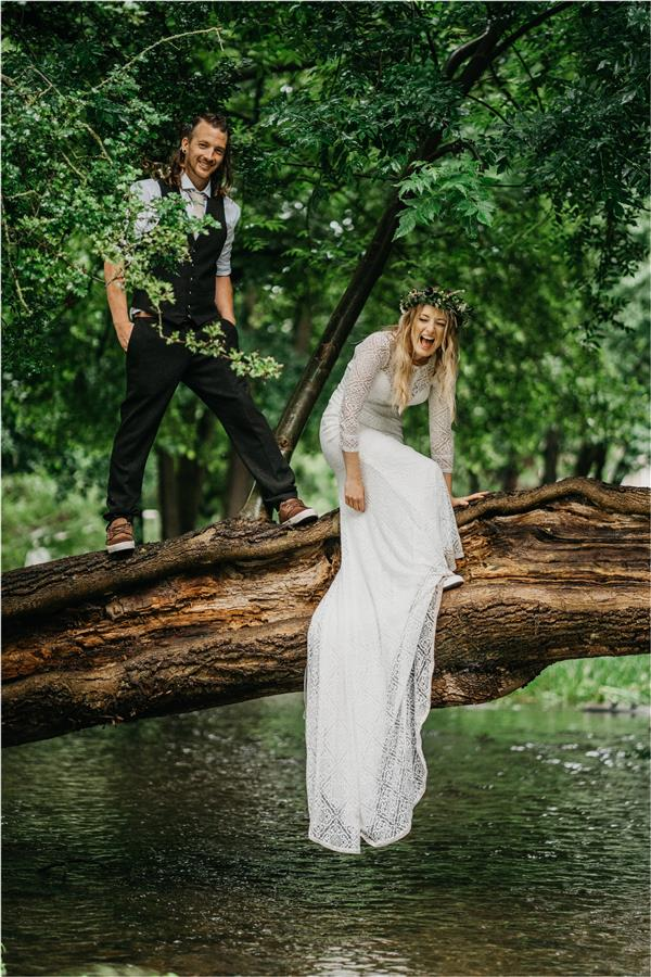 Bride and groom in a tree with happy faces by Ed Godden Photography