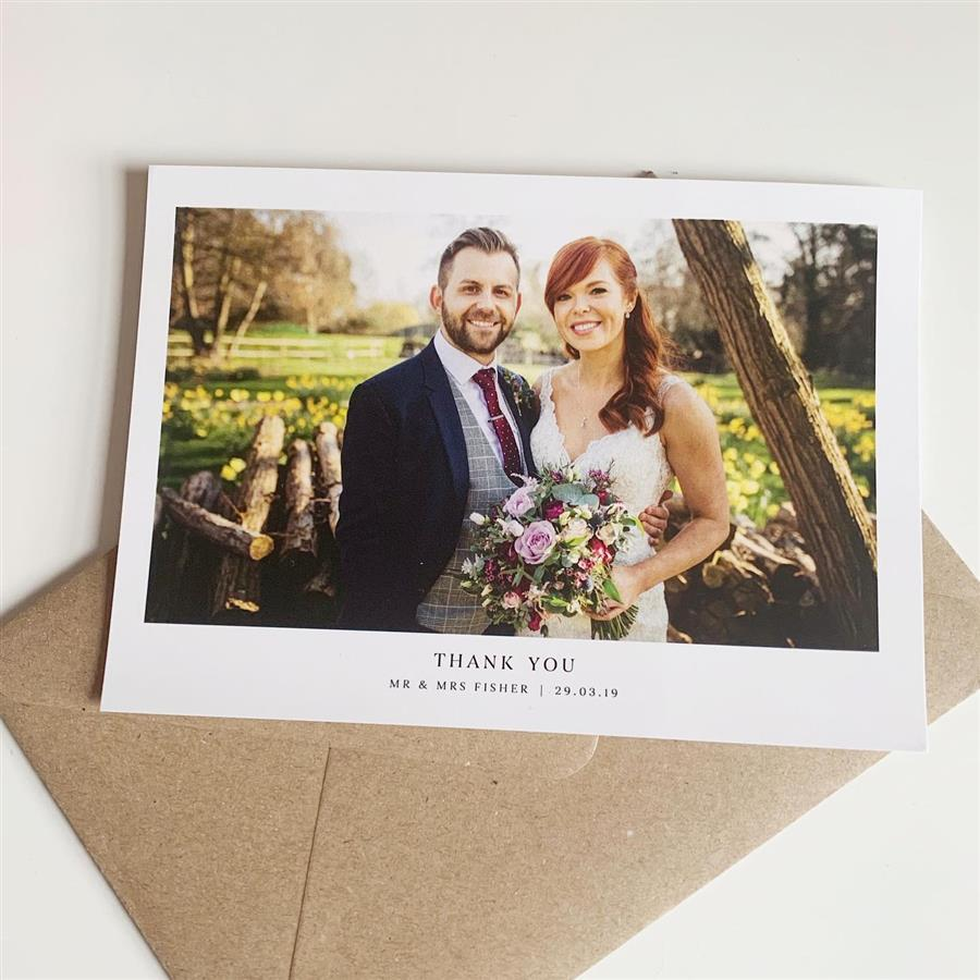 Thank you card from wedding couple stood in field of daffodills