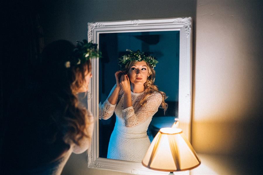Bride to be in a mirror with a flower crown by Ed Godden Photography