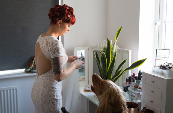 Bride getting ready with dog by Shot by Amy
