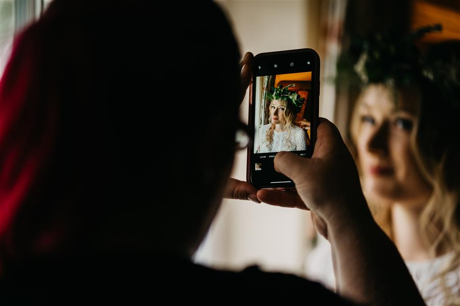 Photo of a photo being taken on a camera phone of a bride to be