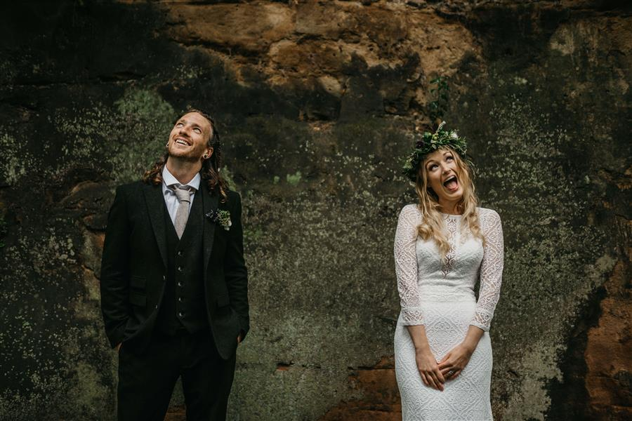 Wedding couple pulling funny faces with Ed Godden Photography