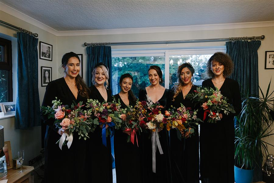 Bride with bridesmaids wearing velvet dresses