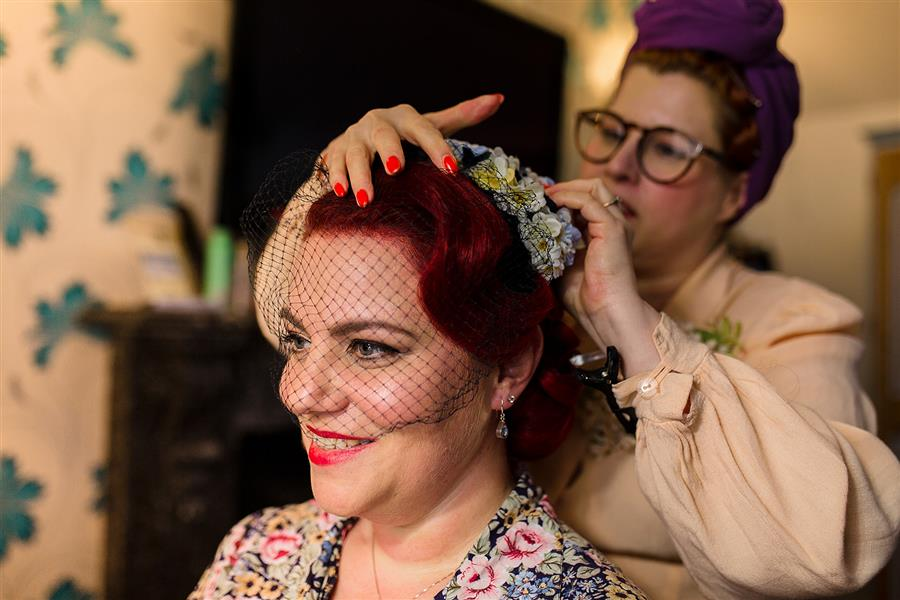 Smiling bride having her hair done by Pin Up Curl