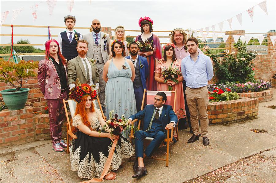 Colourful group shot for alternative wedding by Camera Hannah