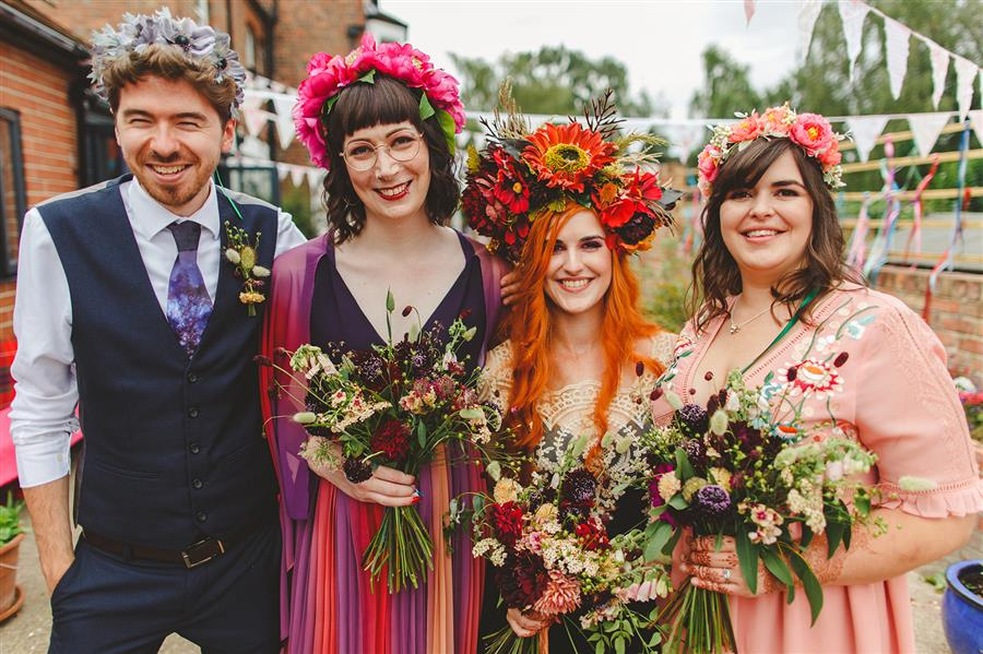 Bride and bridesmaids at alternative wedding with colourful styling