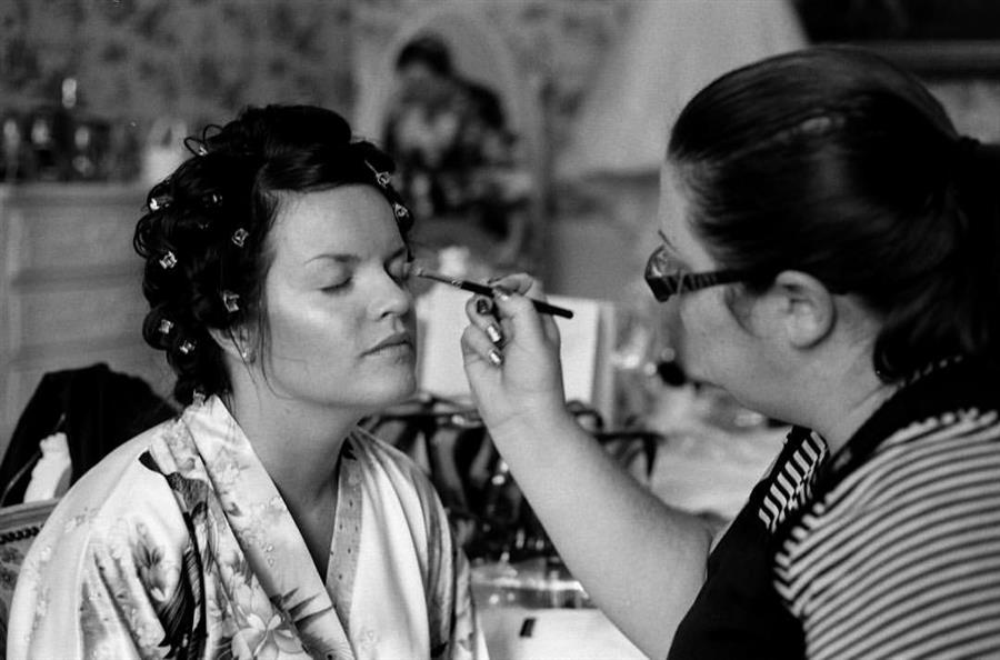 Ms Moo applies eyeshadow to a bride to be at Colwick Hall Hotel