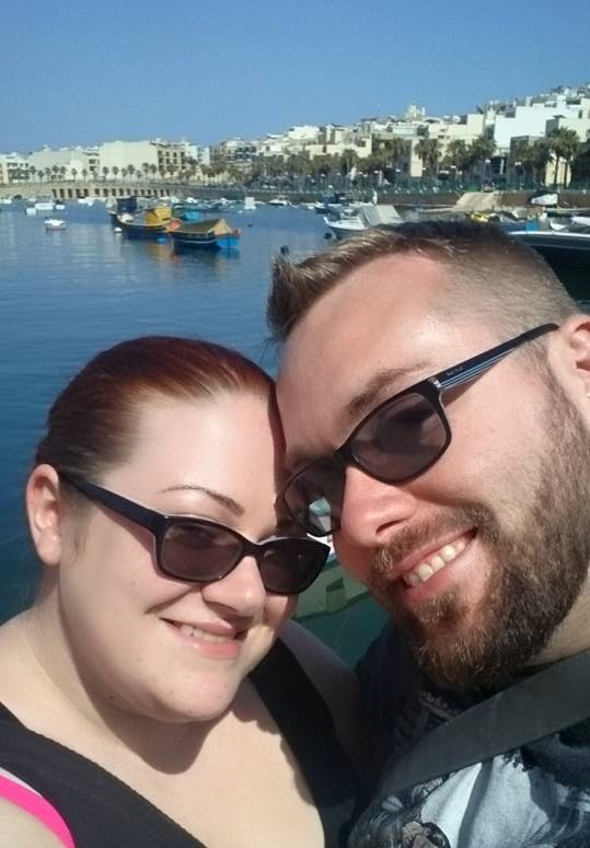 Ms Moo turning 30 on holiday in Malta with Niall in front of a sea harbour with small boats in it